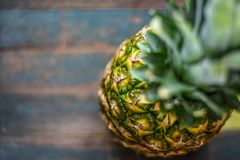 Beautiful fresh pineapple clouseup on rustic backgroup royalty free stock images
