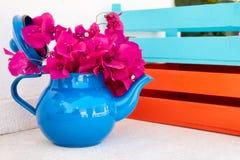 Beautiful fresh red bouganvillea in a decorative tea pot royalty free stock photos
