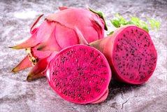 Beautiful fresh red dragon fruit pitaya. On stone background Stock Photo