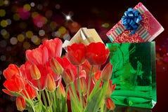 Beautiful  fresh red tulips and gift Stock Photo