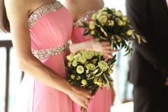 Beautiful fresh roses in wedding bouquet in bridesmaids hands cl. Oseup Stock Photo