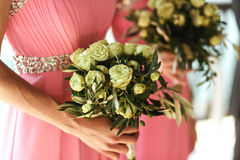 Beautiful fresh roses in wedding bouquet in bridesmaids hands cl Stock Photography