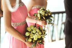 Beautiful fresh roses in wedding bouquet in bridesmaids hands cl. Oseup Stock Image