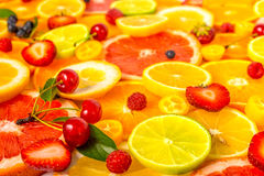 Beautiful fresh sliced mixed citrus fruits as background with di Royalty Free Stock Images