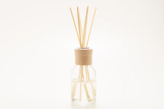 Beautiful incense sticks in a fragrant liquid. Beautiful fresh smelling incense sticks dipped in a fragrant liquid in a glass jar Stock Photography