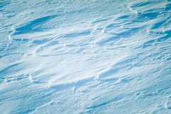 Beautiful fresh snow pattern in minimalistic style. Winter background. Norway, Northern Europe. Close up texture Royalty Free Stock Images