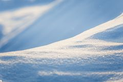 Beautiful fresh snow pattern in minimalistic style. Winter background. Norway, Northern Europe. Close up texture Stock Images