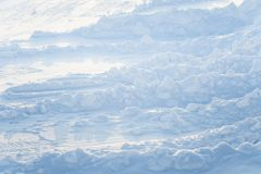 Beautiful fresh snow pattern in minimalistic style. Winter background. Norway, Northern Europe. Close up texture Royalty Free Stock Image