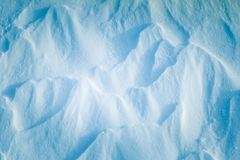 Beautiful fresh snow pattern in minimalistic style. Winter background. Norway, Northern Europe. Close up texture Stock Image