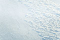 Beautiful fresh snow pattern in minimalistic style. Winter background. Norway, Northern Europe. Close up texture Royalty Free Stock Photo