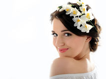 Beautiful fresh spring woman with flowers. In her hair royalty free stock images