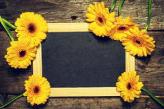 Beautiful Fresh Spring Yellow Gerbers on Old Vintage Wooden Tabl Stock Photo