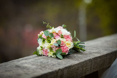 Beautiful fresh wedding bouquet closeup on stone balcony Royalty Free Stock Photography