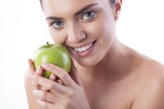 Beautiful fresh woman with green apple. Royalty Free Stock Photos