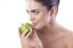 Beautiful fresh woman with green apple. Stock Photos
