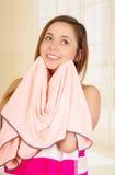 Beautiful fresh young girl drying her face with towel. Close up shot of beautiful fresh young brunette girl drying cleaning her face with towel Stock Photo