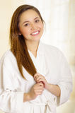 Beautiful fresh young girl wearing white bathrobe Royalty Free Stock Photo