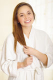 Beautiful fresh young girl wearing white bathrobe Stock Images