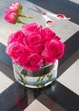 Beautiful freshly cut roses on a table. Beautiful freshly cut roses on a glass table Stock Photography