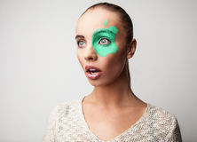 Beautiful friendly girl. With apple paint on her face. Stock Images