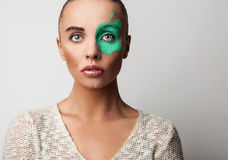 Beautiful friendly girl. With apple paint on her face. Royalty Free Stock Photos