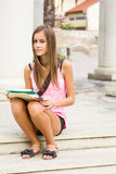 Beautiful friendly teen student girl. Royalty Free Stock Photo