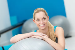 Beautiful friendly woman in a gym Royalty Free Stock Photos