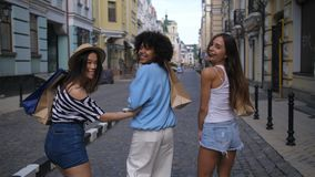 Beautiful friends happy about purchases smiling stock video