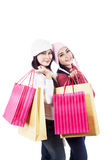 Beautiful friends shop together isolated in white Stock Photos