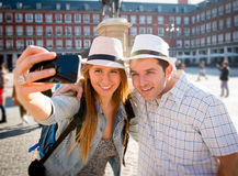 Beautiful friends tourist couple visiting Europe in holidays students exchange taking selfie picture Stock Image
