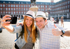 Beautiful friends tourist couple visiting Europe in holidays students exchange taking selfie picture Royalty Free Stock Image