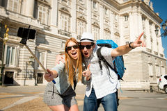 Beautiful friends tourist couple visiting Spain in holidays students exchange taking selfie picture Stock Photo