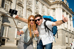 Beautiful friends tourist couple visiting Spain in holidays students exchange taking selfie picture Stock Image