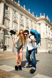 Beautiful friends tourist couple visiting Spain in holidays students exchange taking selfie picture Stock Photos
