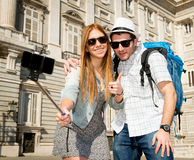 Beautiful friends tourist couple visiting Spain in holidays students exchange taking selfie picture Royalty Free Stock Photography