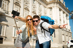 Beautiful friends tourist couple visiting Spain in holidays students exchange taking selfie picture Royalty Free Stock Photos