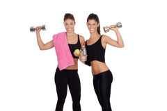 Beautiful friends training lifting weights Royalty Free Stock Images