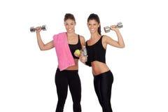 Beautiful friends training lifting weights