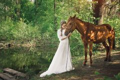 Beautiful friendship between woman and horse stock image