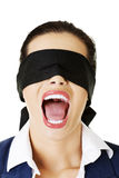 Beautiful frighten young blindfold woman. Portrait of a beautiful frighten young blindfold woman screaming stock photos