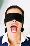 Beautiful frighten young blindfold woman. Portrait of a beautiful frighten young blindfold woman screaming royalty free stock image