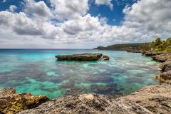 Beautiful Fringing Coral Reef on the coast of Mare, New Caledonia. Cruise ship destination royalty free stock photo
