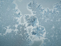 Beautiful frost pattern. On a window Stock Photos