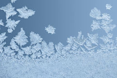 Beautiful frost patterns on glass Stock Photos
