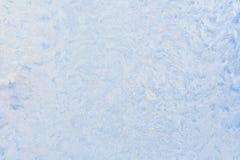 Beautiful frosty pattern on glass. Stock Photos