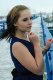 Beautiful frozen girl on bridge at winter Royalty Free Stock Images