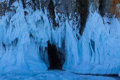 Frozen water in front of the cave on Olkhon island,Russia stock photography