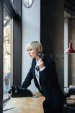 Beautiful frustrated blonde girl make call Stock Photos