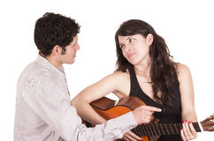 Beautiful frustrated female guitar student and Royalty Free Stock Photo