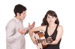Beautiful frustrated female guitar student and Royalty Free Stock Images